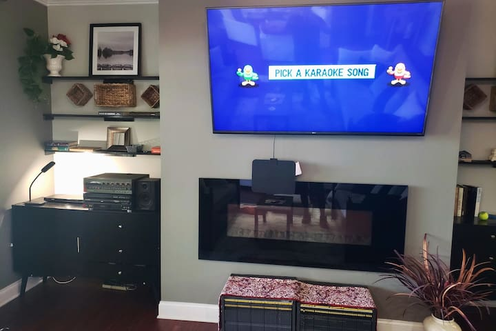 """Family Room  - This is where are the Family Fun stuff is! ~ Karaoke with over 5,000 songs ~ Board Games including AIR PICTIONARY ~ 70"""" Flat Screen Smart TV ~ 4 Single Day Beds with trundles. ~ Remote Controlled Fireplace"""