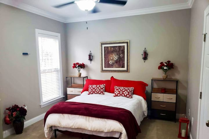 Red Room with private bathroom and a Mac you may utilize during your stay. Laser Printer available to all via bluetooth.