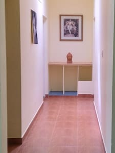 The 120cm wide hallway from living cum dining space to bedrooms and common bathroom.