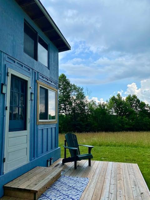 Cute off-grid cabin on Escarpment Hobby Farm