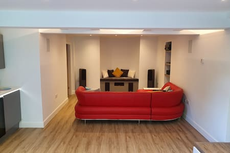 The living area is open plan and the sofa can be easily repositioned to provide additional clearance if required.
