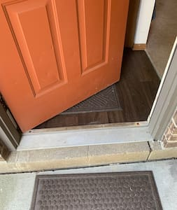 Single step into home entrance.