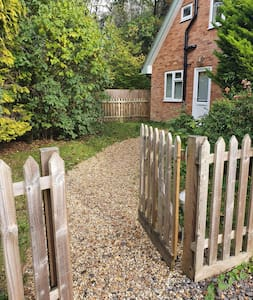 Gravel path leading to a private entrance with single step with threshold