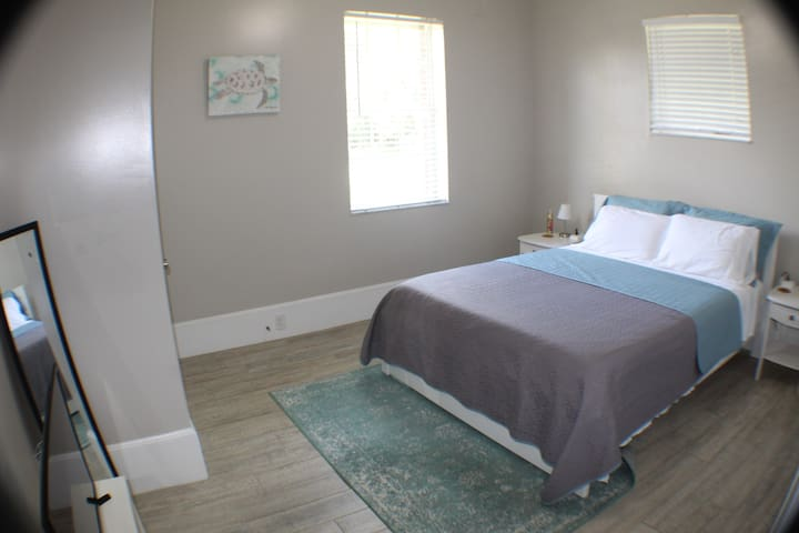 Bedroom 2- queen sized bed with a closet (hangers provided) & a smart TV with a Firestick & Netflix included! **we take the cleaning of our facilities very serious always aim to impress- all sheets, towels, etc. are bleached before each use.**