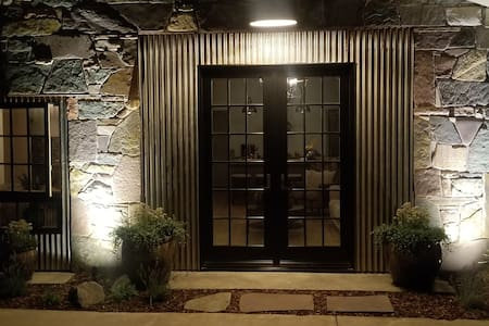 This is the front entrance, well illuminated and flat ground.