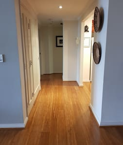 Hall way to bedrooms, bathrooms and laundry