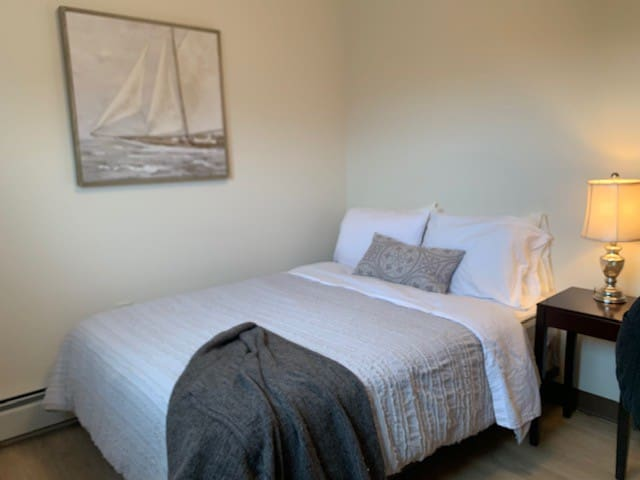 2nd Bedroom features a Full Bed with soft 100% cotton bedding and extra pillows for restful sleep!