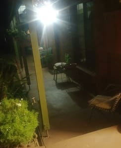 This is the front verandah at night with the outdoor light on. The outdoor light is left on for guests as they arrive and in the evening when they have been out.