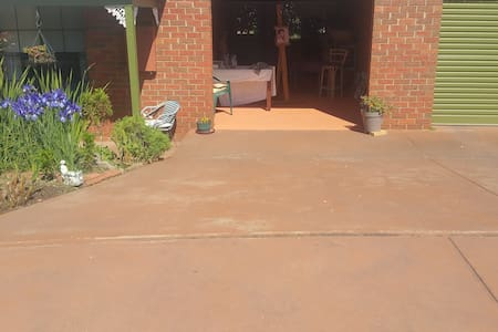 The drive of the accommodation is very wide (3.2m). It is 4.8m in length. There is a small step from the drive to the verandah on the left.