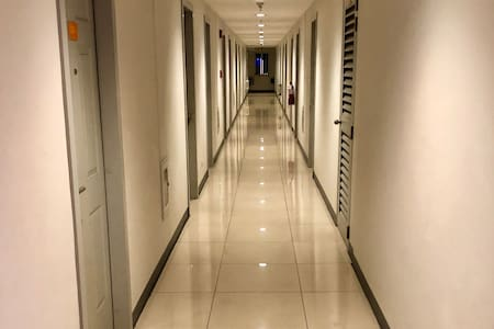 From hallway, unit is located 2nd door on the left and is approximately 36-inches wide  or 0.9144 Meters