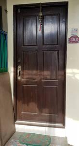 Standard door entry to the room.