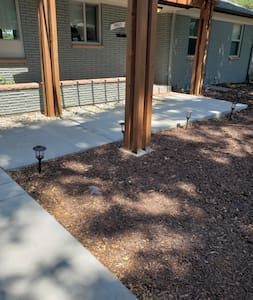 There are solar lights along the front sidewalk as well as a porch light and exterior lights on the garage.