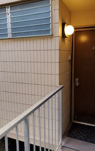 A light next to the door provides easy visibility for nighttime entry.