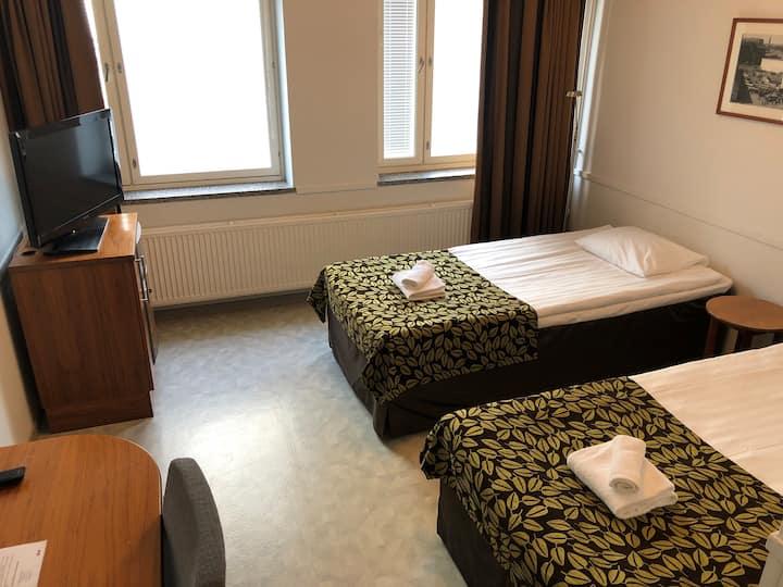 Kahden hengen huone rennossa hotellissa