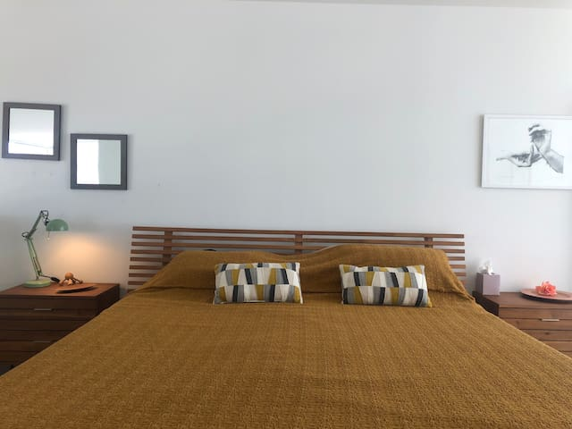 Master bedroom with most comfortable king size bed with Theraptic mattress and bedside tables.