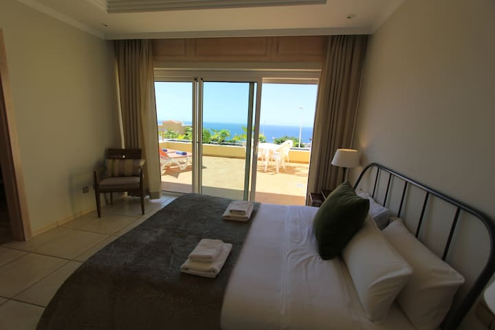 main bedroom with fabulous private terrace and sea views.