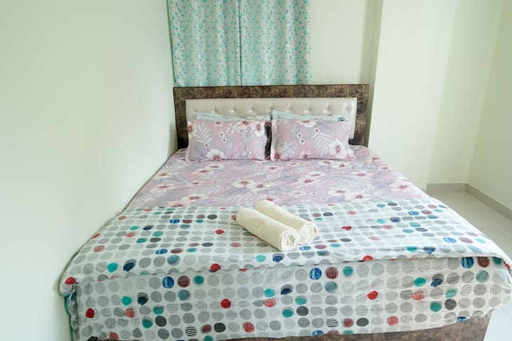 Bedroom with King size Bed, Comfortable Memory foam orthopaedic  Mattress, extra pillows and duvet. Air conditioner and wide windows in the room. Spacious Wardrobes for storage with a long Mirror attached.