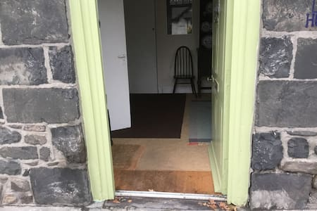 Front door, there are no steps into the house