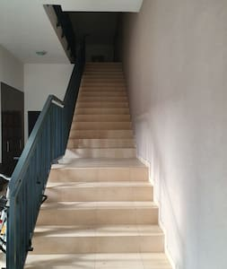 To get to the apartament you will need to go up to the first floor.