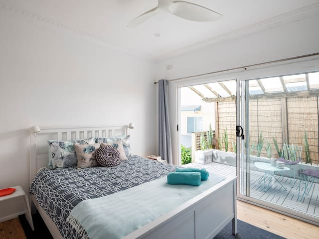 The master bedroom has a private patio  and luxurious en-suite bathroom.