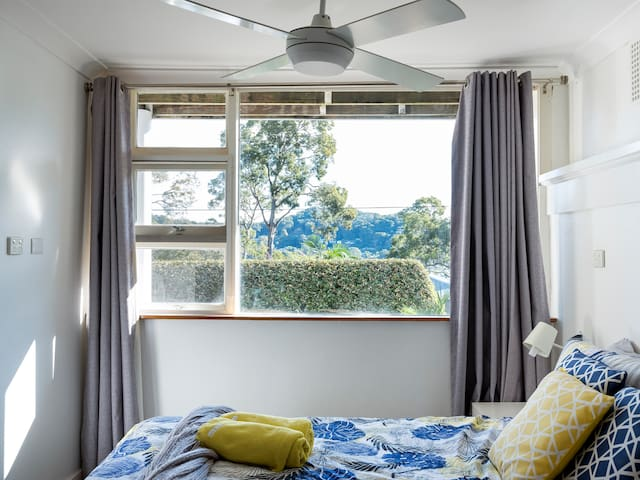 The downstairs bedroom has an adjacent living area with a second television with access to streaming services via the complimentary high-speed NBN internet.