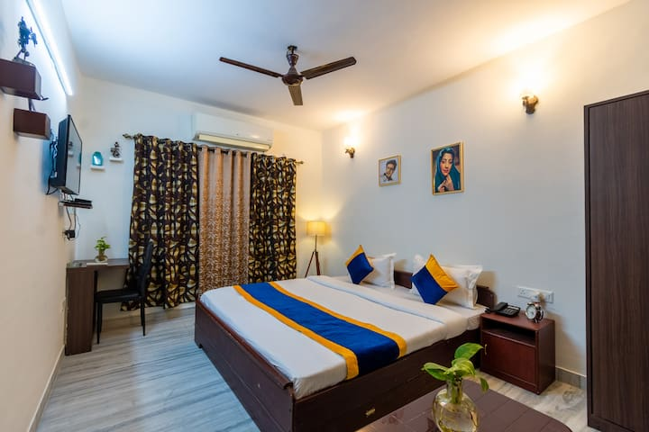 Balmy BNB Tower 2  Room No. 202 It is equipped with double bed, pillows, cushions, duvet, study table and chair, side table, 1.5 ton LG inverter AC, 32 inches TV, tatasky, wall salves, art painting, 2 seater sofa and central table attached washroom