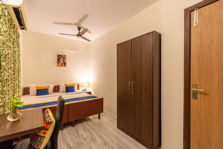 Balmy BNB Tower 2  Room No. 205 It is equipped with double bed, pillows, cushions, duvet, study table and chair, side table, 1.5 ton LG inverter AC, 32 inches TV, tatasky, wall salves, art painting, non-attached washroom