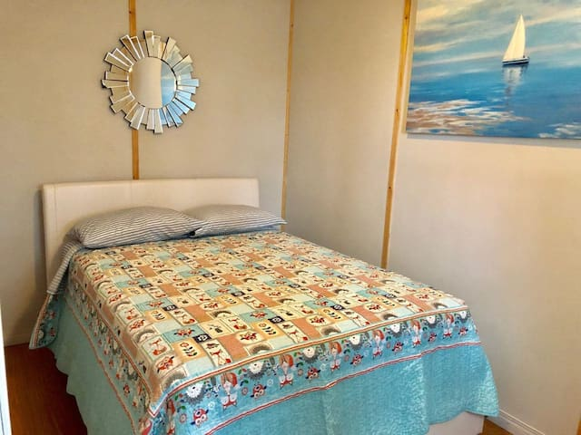 Double bed in the first bedroom