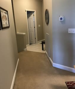 Wide hallway and entry with no furniture to get in your way!