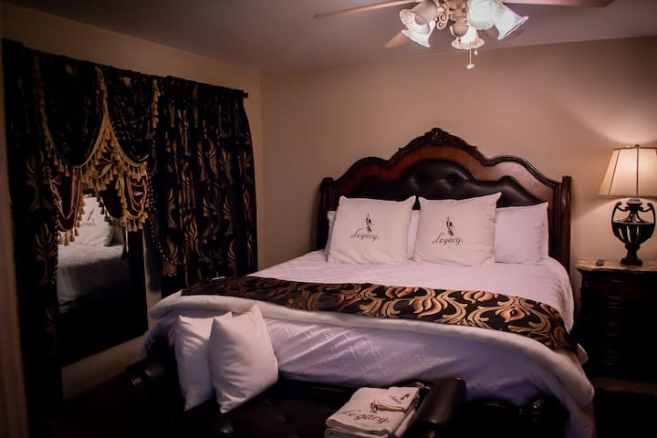 """Private Jacuzzi Suite w/ Private Bathroom.  55""""TV, coffee maker, micro-wave, frig. Fire pit, access to Sauna & Waterfall Shower, and 1hr Massage"""