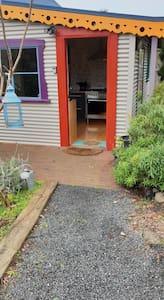 Entry door with key safe on left side of door frame.