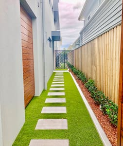 Level Paved entry way on artificial grass.