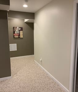 Hallway from living room & main entrance o bathroom. Bedroom is on the right in photo.