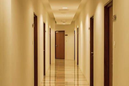 well lit corridor to room