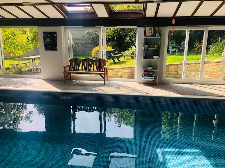 Detached property with heated indoor swimming pool