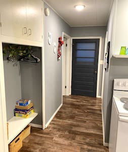 Photo is of inside hallway. Two steps up to the door to get in the cabin.