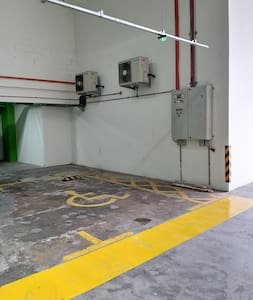 Disable Parking Space at the Level G Parking Level which is next to the entrance door to the lift