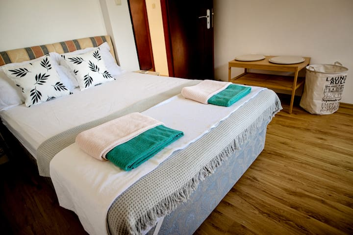 We hope you have a peaceful and restful sleep in this bed with white sheets and soft pillows.