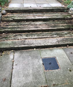 There are three wide steps from the gravel drive to the path.