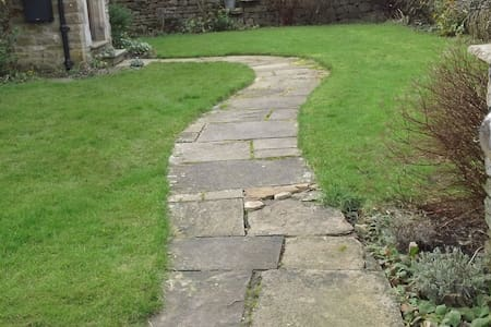 the path is over 81cms in width and is flat and so is the grass ether side.