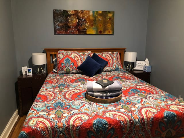 Bedroom 1 has a queen bed. The alarm clock doubles as a USB charger for your electronic devices.