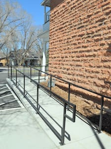 The exterior wheelchair access is directly adjacent to the dedicated handicap parking spot.