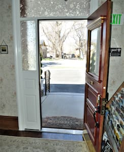 """The front entrance has two steps  or a wheelchair ramp for easy access.  We also have a dedicated, van accessible handicap parking spot.  The front door is over 36"""" wide and will accommodate standard wheelchairs."""