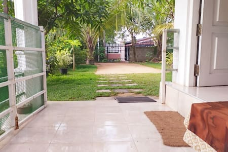 Pathway from the main gate to the home stay with garden on either side.
