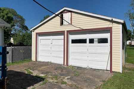The driveway is double wide and goes all the way from the garage, which is behind the house, to the street.