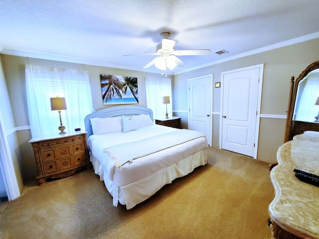 Master Bedroom with King Size Bed, ceiling fan, flat screen tv, & WOW Cable