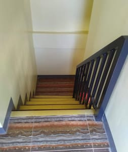 Stairways ( 11 steps)  to Bedrooms and balcony