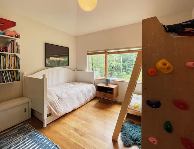 The second bedroom has been set up for kids! We built a bunk which can sleep a 6+ year old and a 3+ year old, and there's a twin bed with a roll-out below.