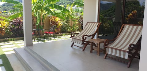 Whispering Palms Apartment- Garden View Apartment