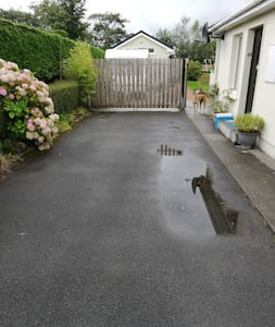 Wide driveway parking space and entrance gate